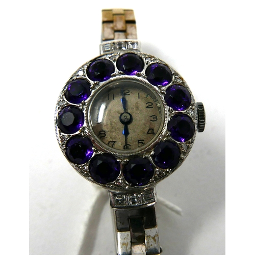 1126 - An Edwardian platinum watch set with diamonds and 11 Siberian amethysts on a 9ct white gold strap, C...