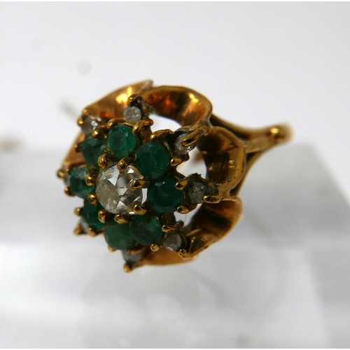 1105 - An 18ct yellow gold, diamond and emerald cluster ring, centrally set with a round brilliant cut diam...