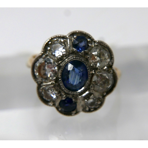 1061 - An Art Deco, 18ct yellow gold and platinum, diamond and sapphire cluster ring set with a central ova...