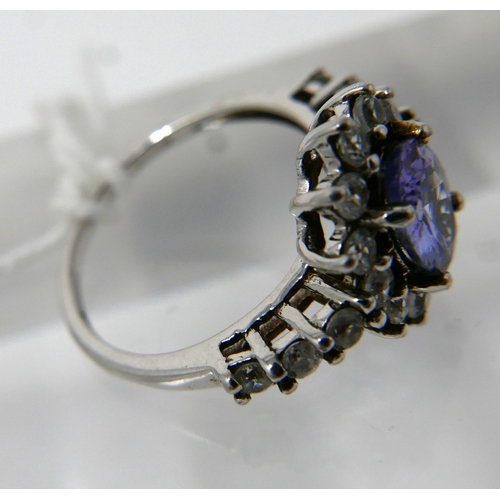 1145 - A 9ct white gold, tanzanite and white sapphire cluster ring, Size: J 1/2, 2.5g....