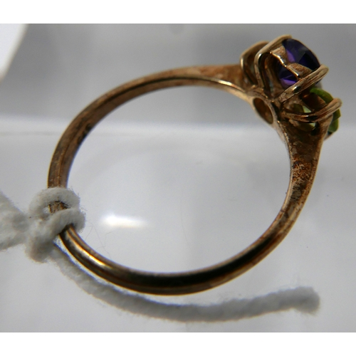 1133 - A 9ct yellow gold clover ring set with amethyst, peridot, citrine and blue topaz to a dimaond centre...