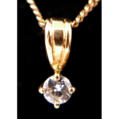 1059 - A boxed, 18ct yellow gold, diamond solitaire pendant on an 18ct yellow gold chain, (0.30 carats), Pe...