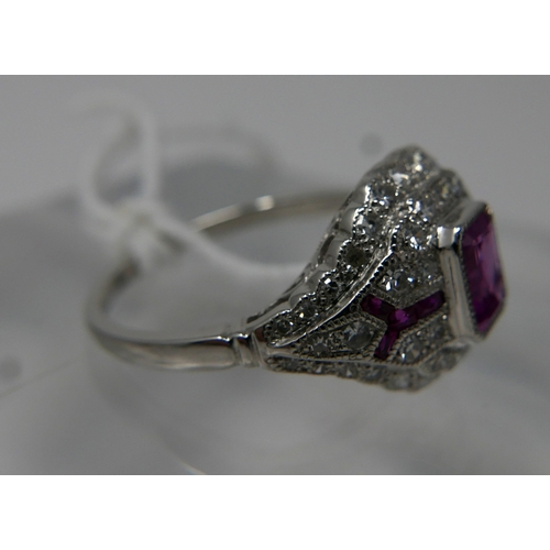 1037 - An 18ct white gold, Art Deco style, diamond and ruby bombe shaped ring, centrally set with a rectang...