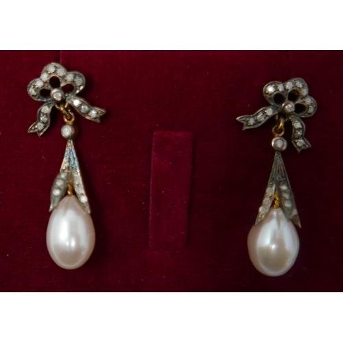 1048 - A boxed pair of antique yellow gold earrings set with diamond-studded bows to a pearl drop, 3.5 x 1....