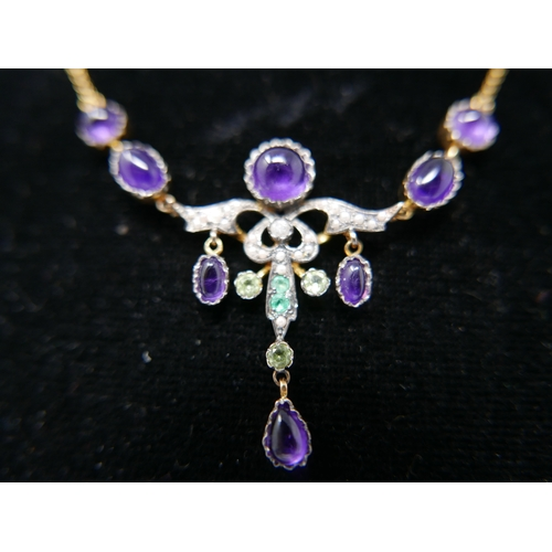 1132 - A boxed, yellow gold drop necklace set with amethyst cabochons, seed pearls, emerald and peridot, L:...