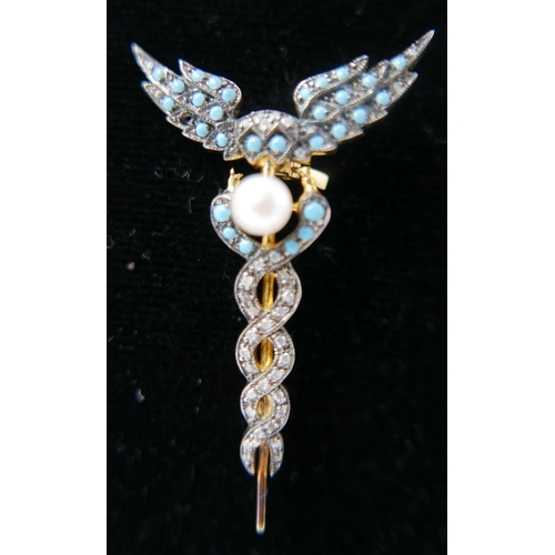 1104 - A yellow gold, caduceus style brooch pave-set with turquoise and diamonds and centrally-set with a r...