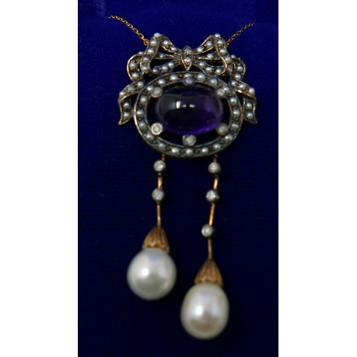 1045 - A boxed, yellow gold double-drop necklace with a central cabochon amethyst set within a mount of see...