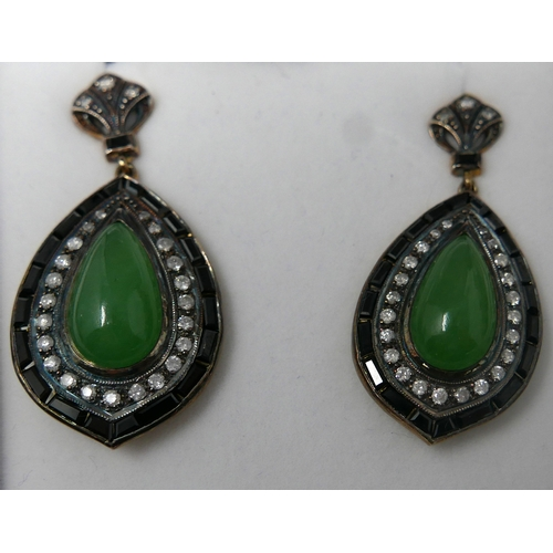 1033 - A boxed pair of drop earrings set with a pear-drop, translucent green jade cabochon surrounded by br...