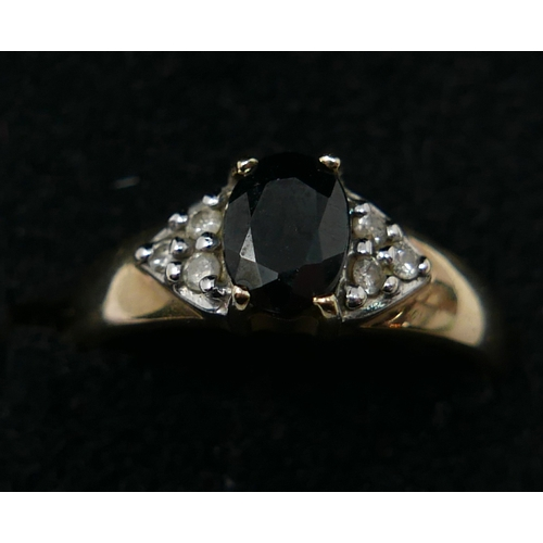 1116 - A boxed, 9ct yellow gold diamond and sapphire ring, centrally set with an oval, faceted sapphire to ...