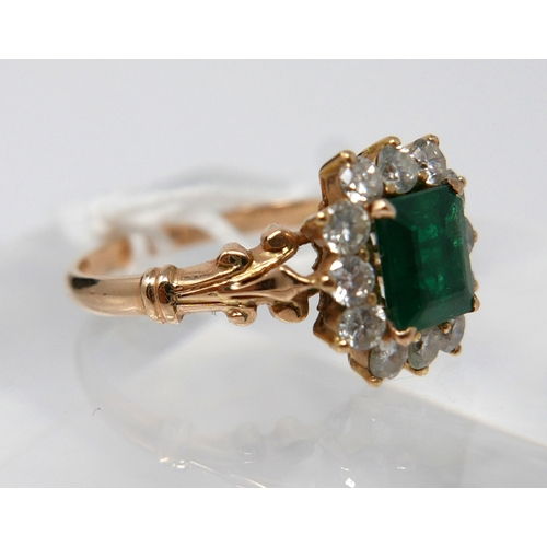 1043 - A Boxed, 18ct yellow gold diamond and emerald cluster ring, the central, stepped-cut emerald (6 x 6....