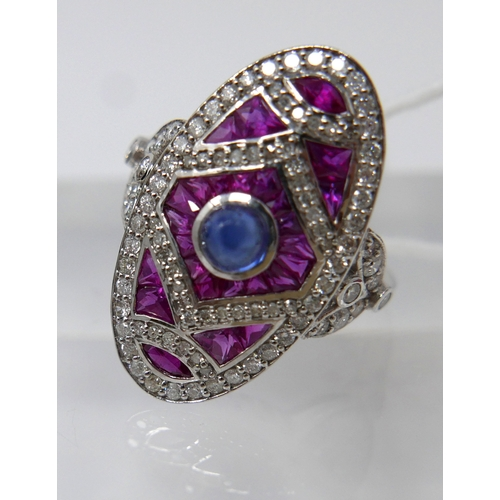 1028 - An 18ct white gold, Art Deco style diamond ruby and sapphire ring, composed of an oval-shaped mount ...