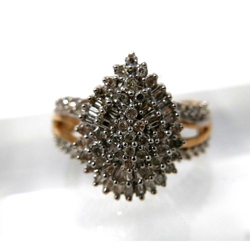 1151 - A 9ct yellow and white gold diamond studded ring set with brilliant and baguette-cut diamonds to dia...