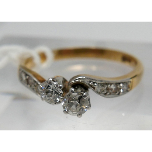 1038 - A boxed, late 19th century, 18ct yellow gold and platinum double diamond crossover ring, centrally c...