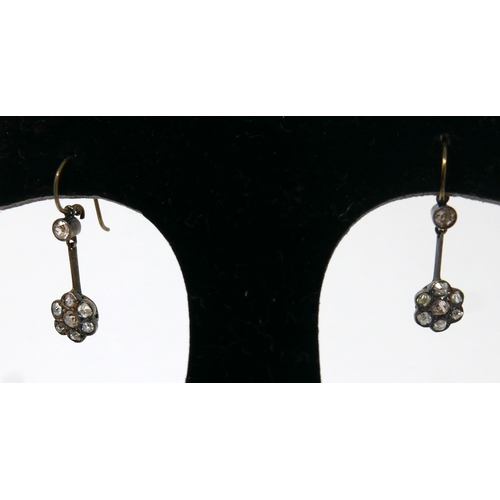 1019 - A pair of antique, yellow gold, rose-cut diamond drop earrings composed of a single diamond suspende...