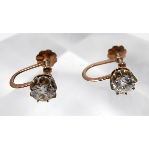 1053 - A pair of 18ct yellow gold, Victorian, diamond solitaire earrings with screback fittings, Diamond di...