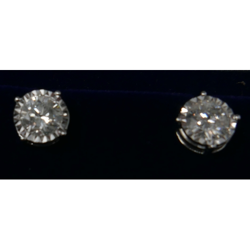 1035 - A boxed pair of 18ct white gold, diamond solitaire stud earrings (2.17 carats total), 4.8g...