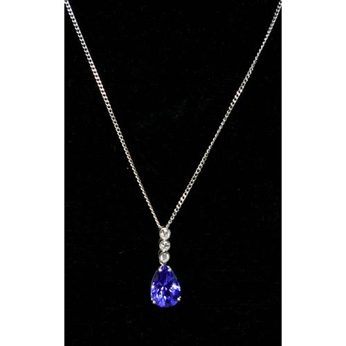 1069 - A boxed, 18ct white gold, diamond and tanzanite pendant on 9ct white gold chain, pendant: 1.8 x 1.1 ...