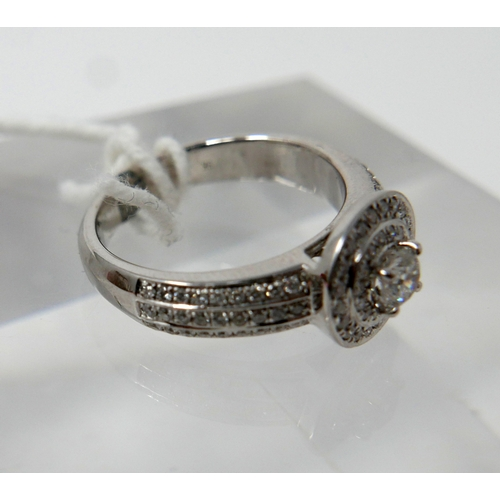 1123 - An 9ct white gold, brilliant-cut diamond cluster ring to 3-row, diamond set shoulders, (0.70 carats ...
