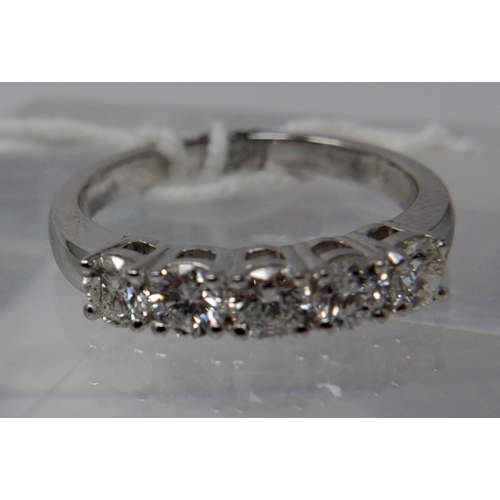1110 - An 18ct white gold, 5-stone brilliant-cut diamond ring, (0.80 carats total), Size: M, 3.8g....