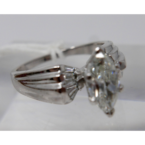 1080 - A 14ct white gold diamond solitaire ring, centrally set with a marquise-cut diamond (1.25 carats) to...