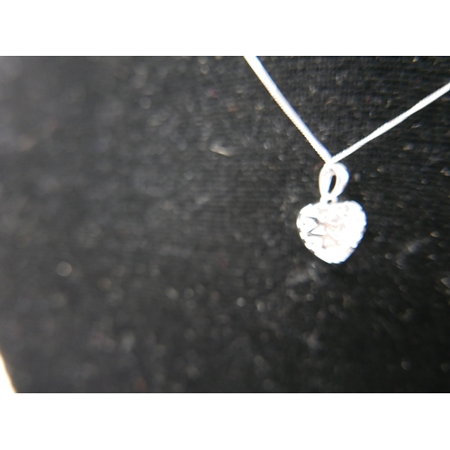 1077 - A boxed 9ct white gold and pave-set diaond heart-shaped pendant on 9ct white gold chain, L: 35cm, 2g...