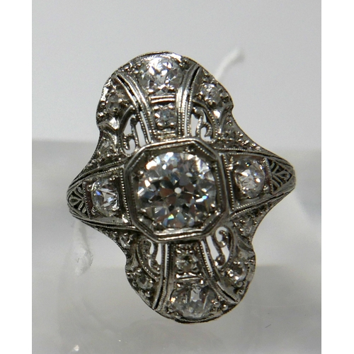 1001 - An 18ct white gold, Art Deco ring set with a large brilliant-cut diamond radiating to a further 8 di...