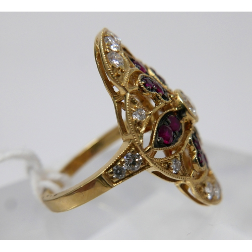 1115 - An 18ct yellow gold, ruby and diamond ring, set with a central round, brilliant-cut diamond to ruby ...