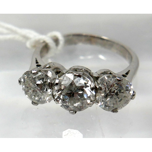 1009 - An 18ct white gold, 3-stone brilliant-cut diamond ring, (3.22 carats total), Size: L, 4.6g....