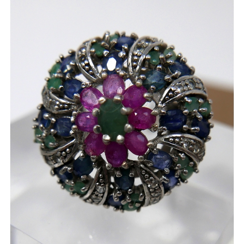 1078 - A sterling silver, emerald, ruby and sapphire cluster ring in the Mughal style, Size: G, 12.7g. Clus...