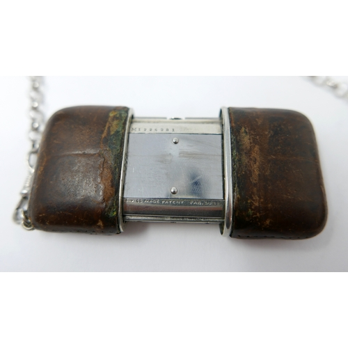 1074 - A Movado Ermeto silver and leather self-winding purse watch, square dial with Arabic numerals, signe...