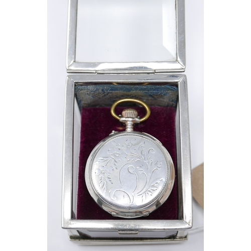 1102 - A silver plated and glass pocket watch display stand, together with a silver open face pocket watch,...
