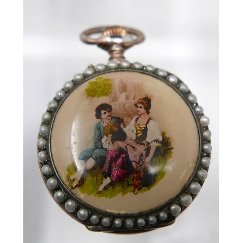 1279 - A white metal and seed pearl open face fob watch, the enamel dial with Roman numerals, gilt out make...