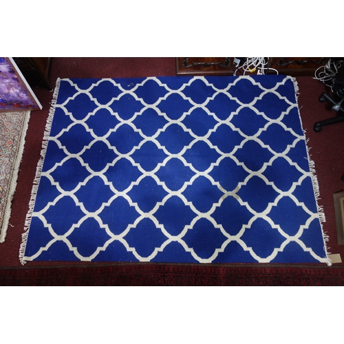 102 - An Indian agra carpet with blue & white design, 224 x 167cm...