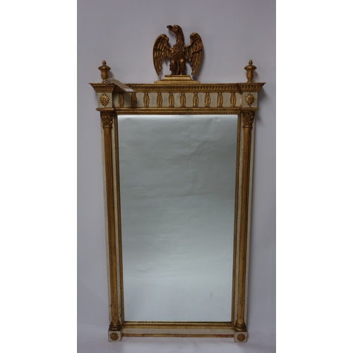25 - A Regency style pier mirror, with eagle finial above reeded columns, 143 x 71cm...