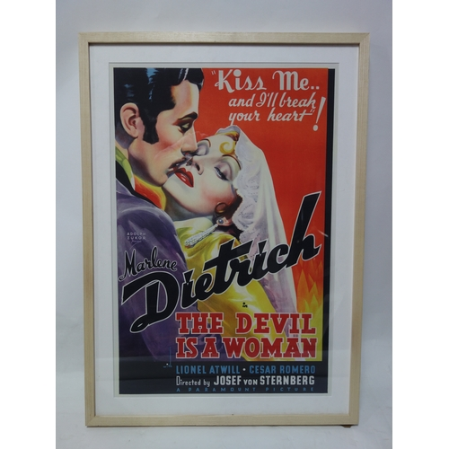 51 - A reproduction movie poster for The Devil is a Woman starring Marlene Dietrich, bearing King & McGaw...