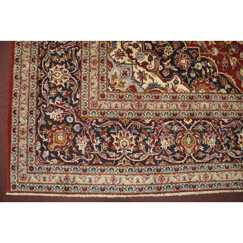 70 - A Central Persian Kashan carpet, central double pendent medallion with repeating spandrels on a roug...