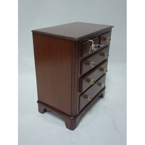 77 - A Victorian mahogany apprentice piece, miniature chest of drawers, H.38 W.32 D.20cm...