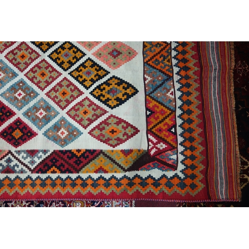 78 - A South West Persian Qashqai kilim, repeating stylised geometric motifs on an ivory field within sty...