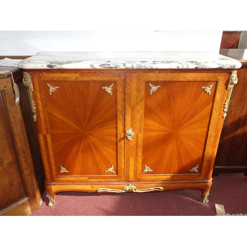 95 - An early 20th century French walnut cabinet, with marble top and gilt metal mounts, the two doors en...