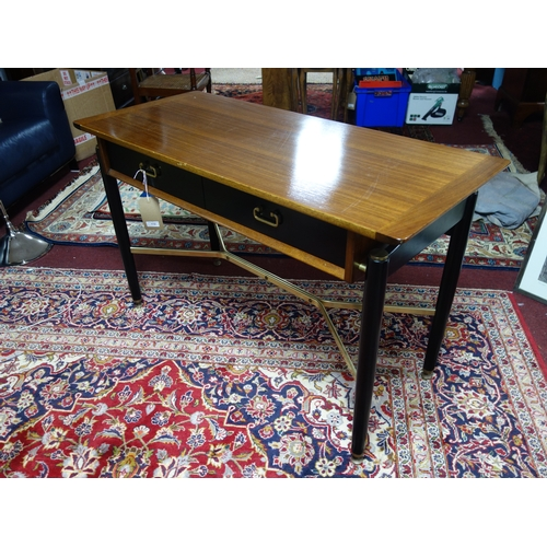 112 - A mid 20th century G-plan teak top desk by E.Gomme, with two drawers raised on tapered legs, H.74 W....