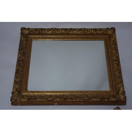 121 - A 19th century gilt framed rectangular wall mirror with foliate acanthus leaf decoration. H.74 W.88c...