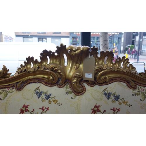 127 - A Rococo style gilt wood bedhead, 110 x 208cm...