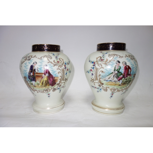 145 - A pair of hand painted baluster form temple jars. H.26cm...