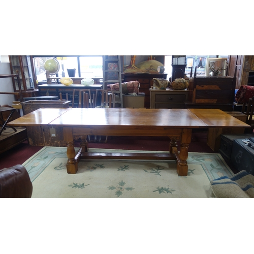 160 - A cherry wood extending dining table with two leaves, H.74 W.198 closed W.304 with leaves D.100cm...