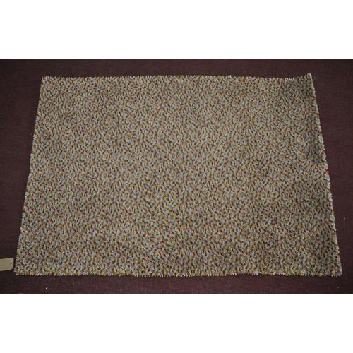 173 - A John Lewis rug with multi beans design, 170 x 116cm...