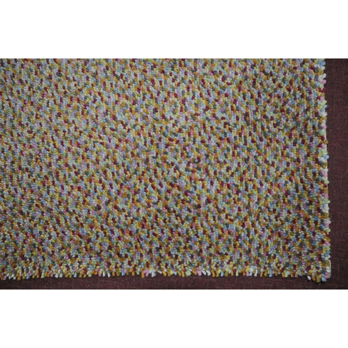 173 - A John Lewis rug with multi beans design, 170 x 116cm...