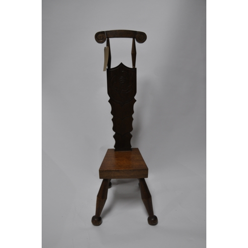 192 - An Arts and Crafts teak chair...