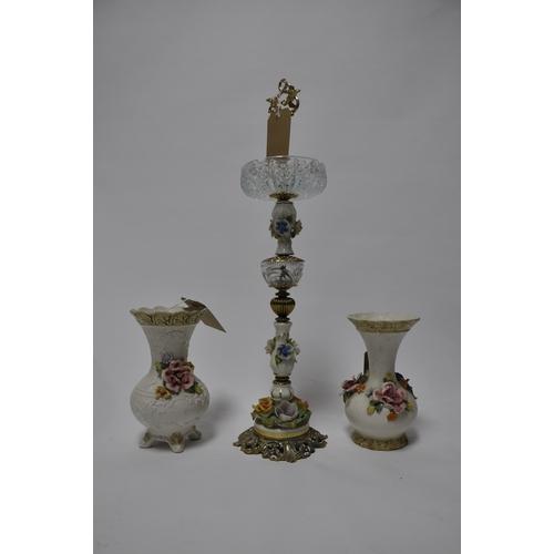 193 - A floor standing flower encrusted porcelain cigar ashtray (H.69cm) and 2 similar vases....