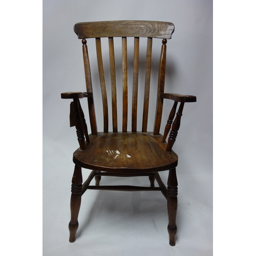255 - An early 20th century oak Windsor armchair...