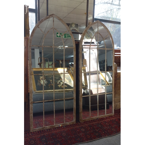 306 - A pair of arched garden mirrors, 158 x 67cm (2)...